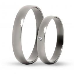 Парные обручальные кольца из титана с бриллиантом Т1014тс